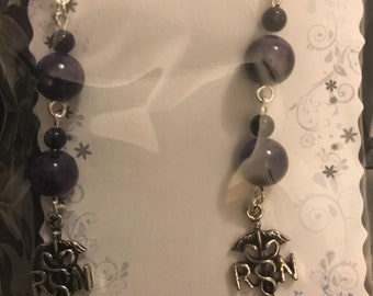 RN dangle purple gemstone