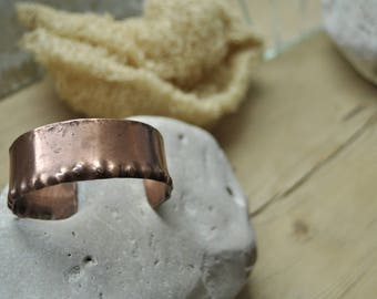 Wrought copper rigid bracelet with embossed