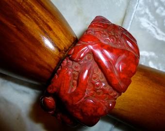 Vintage carved dog & squirrel with oak leaves red bakelite bangle bracelet