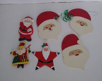 6 Santa Claus ornaments. Metal, clay. Great Christmas decor. Fun to use as holiday gift tags
