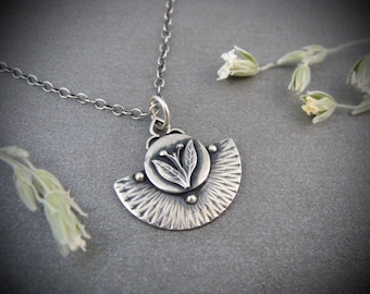 earthing ... silver pendant