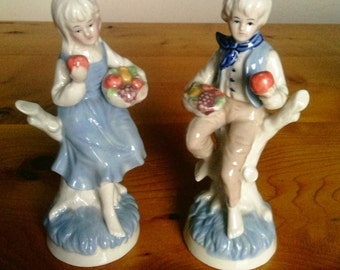 A Pair Of Vintage Boy And Girl Porcelain Figurines With Fruit Baskets