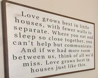 Love grows best in little houses horizontal wood framed sign