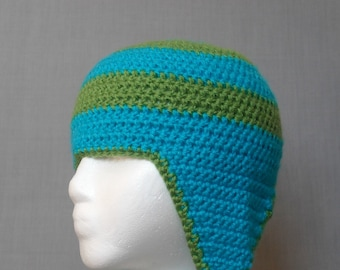 crocheted blue and green striped winter hat with earflaps and braided tassels