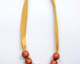 Yellow ribbon beaded necklace, wooden beads, mothers day gift, boho jewelry, chewelry, baby friendly necklace, tassel necklace, green tassel