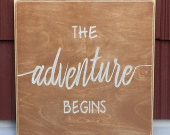 "Rustic Wood Sign - The Adventure Begins - 12"" x 12"""