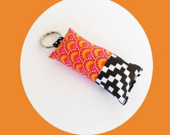 Waves fabric key fob, orange and pink neon and black and white checkered
