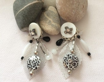 pretty pair of earrings white with touches of black
