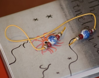 Chinoiserie bookmark in blue, white, red, and yellow, hardback size