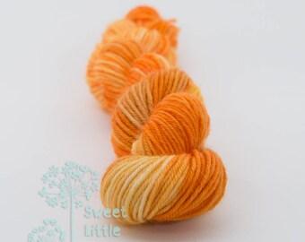 Mini skein - Beautiful hand dyed pumpkin yellow orange hank of sock weight superwash merino wool