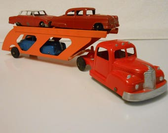 1950's Tootsitoy Car Carrier with Three 40's Roadsters