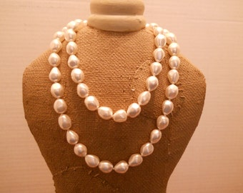 "Glowing Swarovski pearl necklace, 32"" in length, Hand Knotted on Silk"