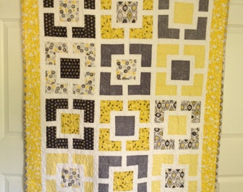 "Yellow and Gray ""Hole in the Wall""  quilt"