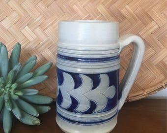Large blue and white pottery mug