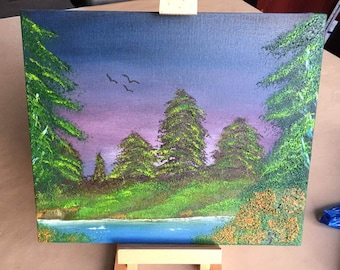 An original oil painting on canvas of a forest , realaxing to look at .