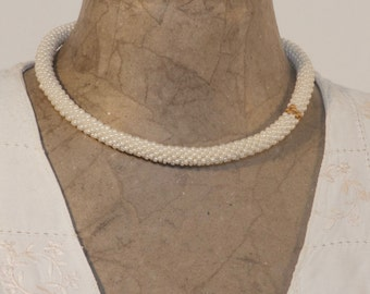 Ivory coloured necklace with Gold plated beads