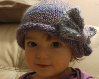 Roll brimmed Baby Hat with a Big Bow motif.  Hand Knitted to order. Big Bow Hat with a rolled brim. Prem to adult sizes.