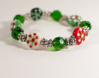 Red, White, Green and Black Snowflake Glass Bead Stretch Bracelet
