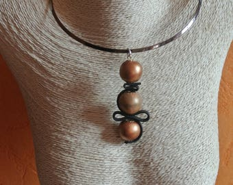 necklace on metal stand