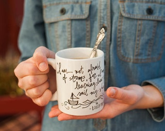 Mug Quote: I am not afraid of storms, for I am learning to sail my ship.by Louisa May Alcott. Little Women. Handpainted. Porcelain whimsical
