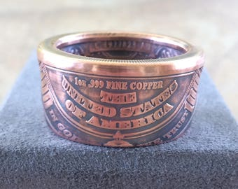 100 dollar coin ring