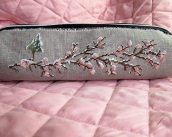 Black clutch with embroidered design