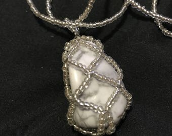 Silver beaded necklace with a beaded howlite pendant