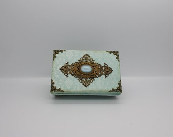 Vintage style alterd box in aqua and with brass decor