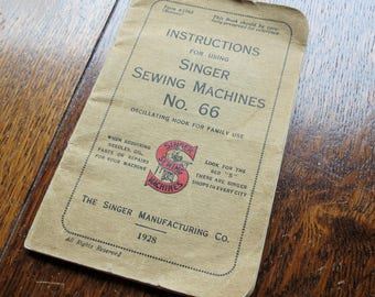 An original Singer Sewing manual. For the Singer Sewing Machine number 66.  Dated 1928.
