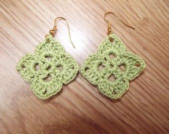Earrings crochet in green color.