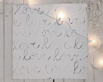 cursive love black and white wooden sign