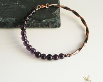 Semi-rigid hand-woven copper bracelet and purple glass beads