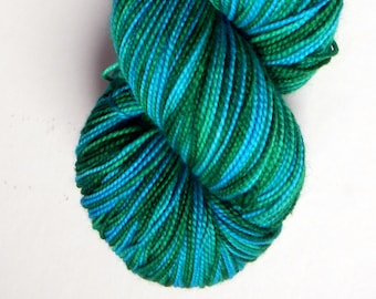 Hand dyed blue and green 100% merino superwash sock yarn