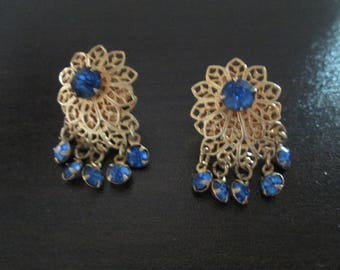 Gold flower screw back earrings with blue crystal accents from 1920's