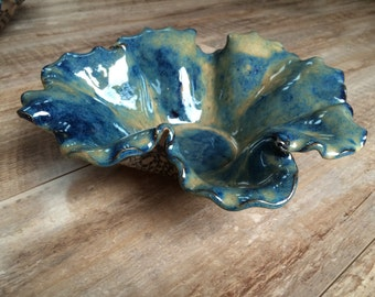 Pottery blue bowl with flower shape and doily design