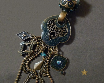 Pendant with blue enameled bronze metal charms