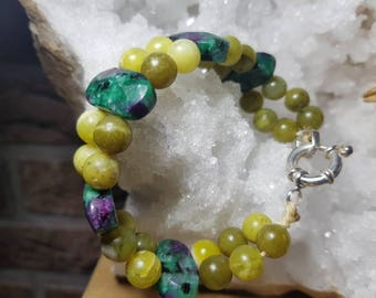 Tanzania zoisite faceted ruby bracelet and peridot in India Ball