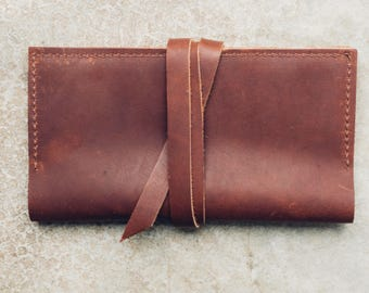 the wrap wallet in brown // pure leather wallet with card + cash + phone pocket // leather wrap-around strap closure
