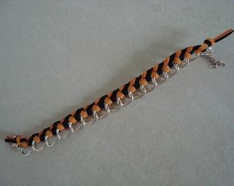 Bracelet black and yellow orange, braided chain