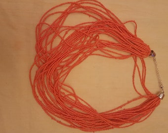 African orange multi-strand beaded necklace