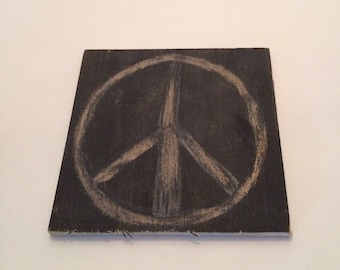 Revealing Peace: peace sign sanded on painted bass wood