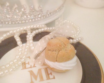 necklace with delicious pastry puffs with whipped cream