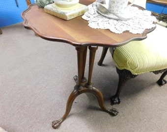 antique eagle clawfoot side table