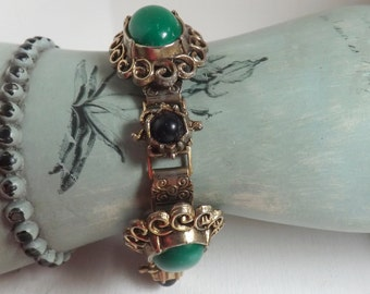 Vintage green and black early plastic embossed bookchain bracelet with gold filigree accents