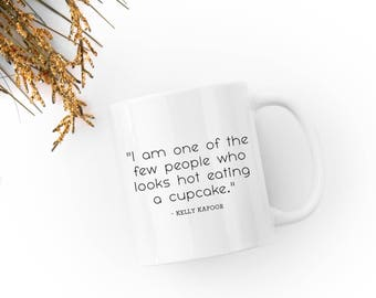 """Kelly Kapoor Quote - """"I am one of the few people who looks hot eating a cupcake."""" - The Office  - Mindy Kaling-  White 11 fl oz. Coffee Mug"""