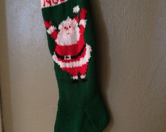 Personalized hand knitted Christmas stocking with santa