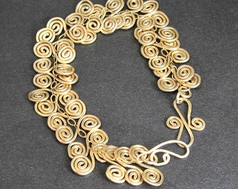 Hammered curl shapes Bracelet 22