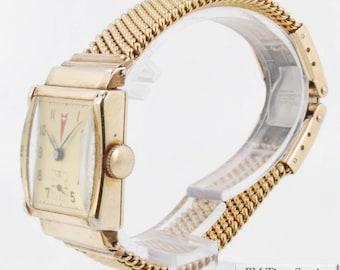 Avia vintage wrist watch, 17 Jewels, yellow gold filled rectangular case, Pontiac logo on dial