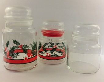 Three round glass jars with bubble lids