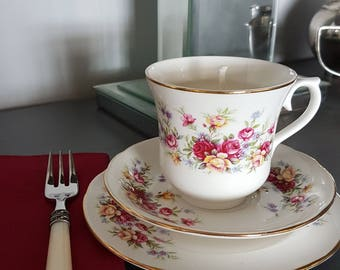 Queen Anne Bone china trio, pink, gold and pale blue flower design, wtih white unsented candle